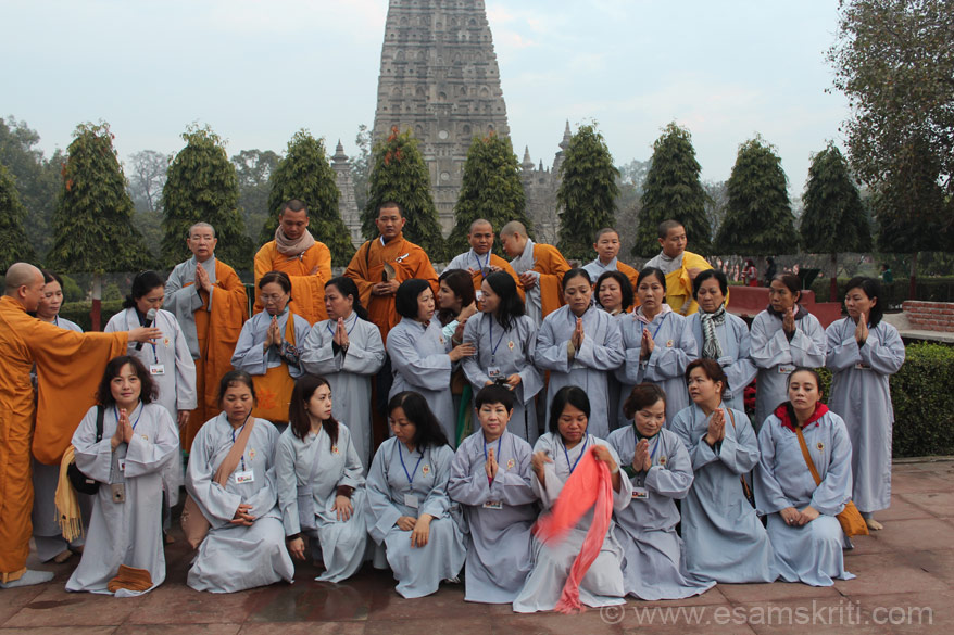 Vietnmese devotees and monks with Bodhgaya temple in background. Note that all devotees are wearing a grey color gown or dress below which they wore clothese they usually wear. Wish someone