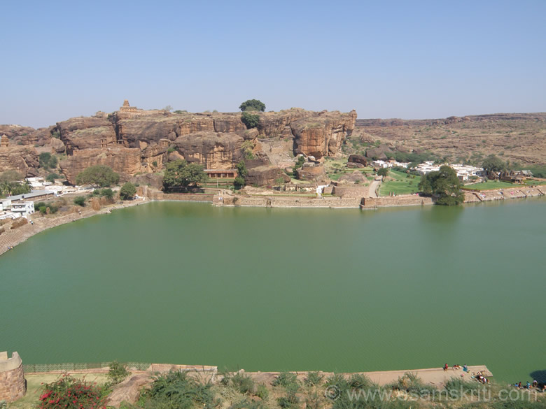 U see a view of Badami Fort taken from the caves area. Even while experimenting in temple building they evolved the proto-type of the famous Southern Vimana style which the lower and upper Shivalaya (temple that you see on hill top) represent. Water body is Augustya Tirta Maha Sarovar. There is  something divine by this sarovar and the caves. Very good vibrations in the place.
