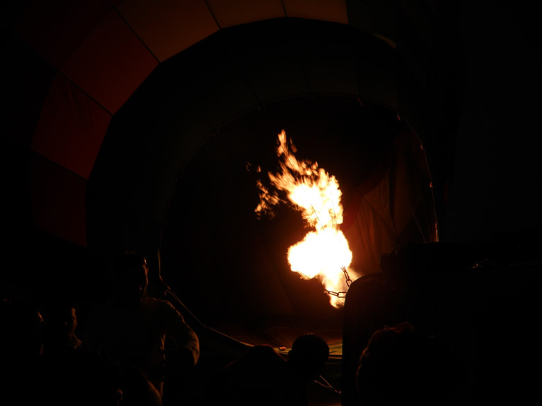 There is a LPG burner that is used to pump hot air into the balloon, u see the flame.