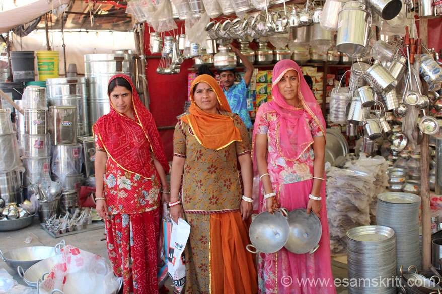 In the same shop three Rajput women in lehenga dress. It is so comfortable. Earlier most women wore cotton dresses ie very good for for Rajasthan where it is hot. Due to increase in  cotton prices some women shifted to nylon ie not as comfortable. To see more pics of Nagaur Cattle Fair <a target=_blank href=http://www.esamskriti.com/photo-detail/Nagaur-Cattle-Fair.aspx>Click here</a>