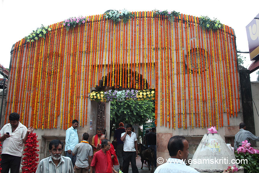 """Entrance to Kamakya Temple. 29th September 2013 was an auspicious day, forget the reason, hence entrance decorated with flowers. ``The temple came into prominence after its site came to be recognised as a most holy Pitha where the Pudendum from the body of Sati cut into pieces by Vishnu``s discuss had fallen, and this led to the spot being called the Yoni-Pitha``. It is one of the 52 Shakti Peethas in India. To know name of each Shakti Peeth<a href=""""http://indiaforyou.in/spirituality/shaktipeeth.php"""" target=""""_blank"""">Click here</a>"""