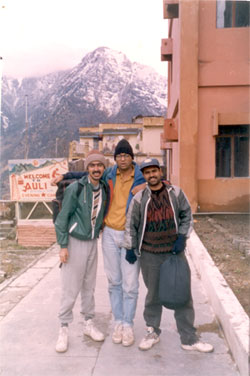To reach Auli you need to drive down from Rishikesh & get off at Joshimath enroute to Badrinath. (app 8-hour bus drive, much shorter by car). From Joshimath there is a ropeway that takes you to Auli. Here you see three members of the group outside the ropeway building.