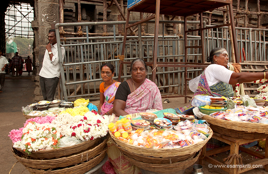 Ladies outside Arunachaleswarar Temple Thiruvannamalai. You can know how popular a temple is with devotees by the number of ladies selling flowers and sadhus sitting outside temple.
