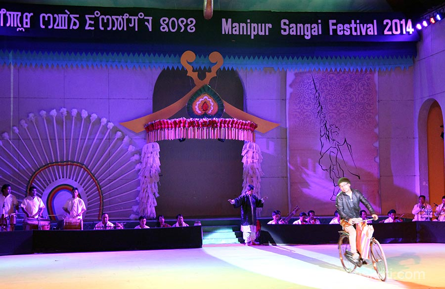 Opening ceremony is about life and working in Manipur at a glance. Everyone laughed when this person rode on cycle. Please help with story.