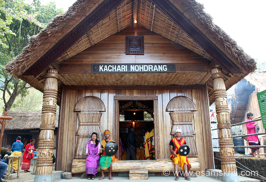 "Entrance to typical Kachari home. Of all the tribal homes at Hornbill this was only one with some artistic wood work as you see on two pillars. Dimasa are part of the greater Kachari group - one of the ancient Kachari tribes. To read about their history <a href="" http://dimasatribe.blogspot.in/p/history-of-dimasa.html"" target=""_blank"">Click here</a>"