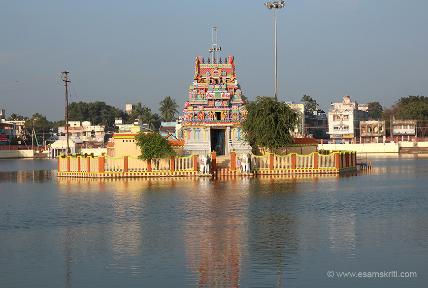 "Water tank on west side of temple as is the case elsewhere. ""Somaskanda refers to a manifestation of Shiva with Skanda and Uma by his side. Thiyagaraja represents the Somaskanda manifestation of Shiva at Thiruvarur and at a few other shrines. Thiyagarajar is referred to as Veedhi Vitankar in the Tevaram hymns. Thiyagaraja is associated with the Ajapaa Natanam."""