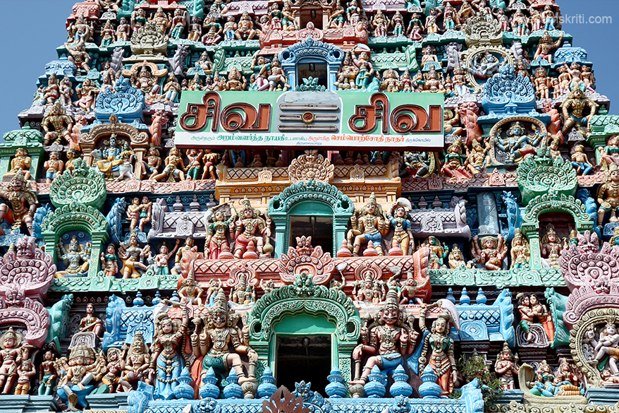 "Centre part stuccos of gopuram.  ""Devotees perform abishek to Lord and Mother and offer Vastras.  Devotees pray for wedding, child and education boons."""