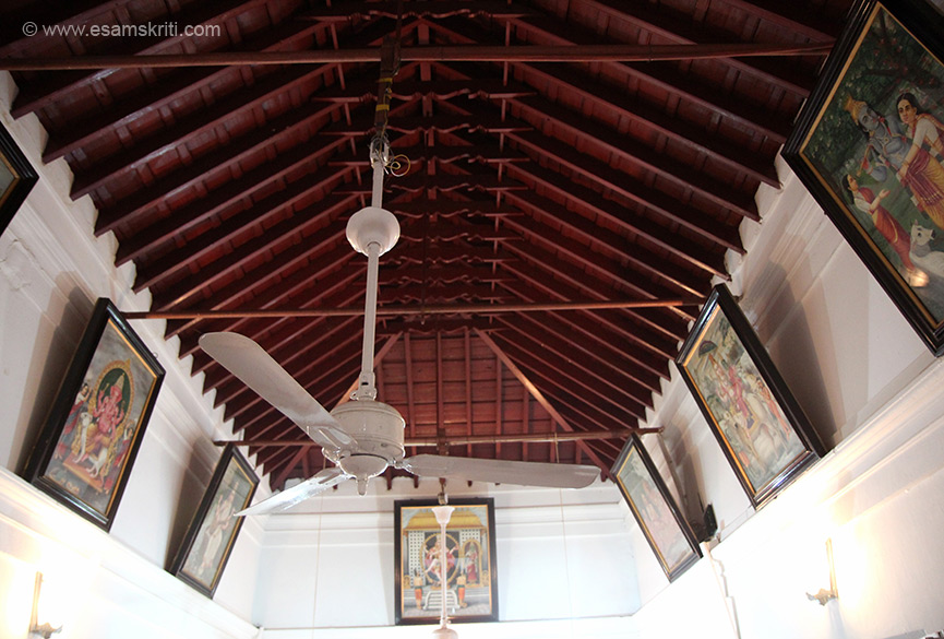 Ceiling of the room where the owner sits. It has pictures of Gods on either side, note wood work. Chettinad homes are known for their woodwork and tiles as you shall see.