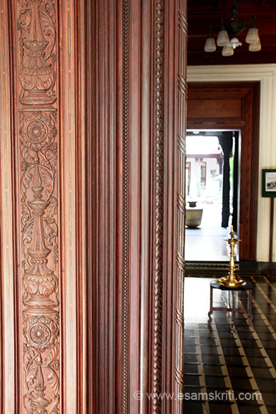 "Wooden panelling of door at entrance. Right of pic is reception and where you see the brass ghada is the courtyard. ""K.V.A. L. M. Ramnathan Chettiar was amongst the pillars of the community in the period between the wars.