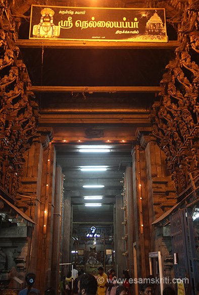 "Temple entrance, centre is Nandi. Note wood images on either side. "" According to the puranas, both the Gopurams were built by Muluthukanda Rama Pandiyan and the other important parts of the temple were constructed by Nindraseer Nedumaran who reigned in the 7th century A.D."""