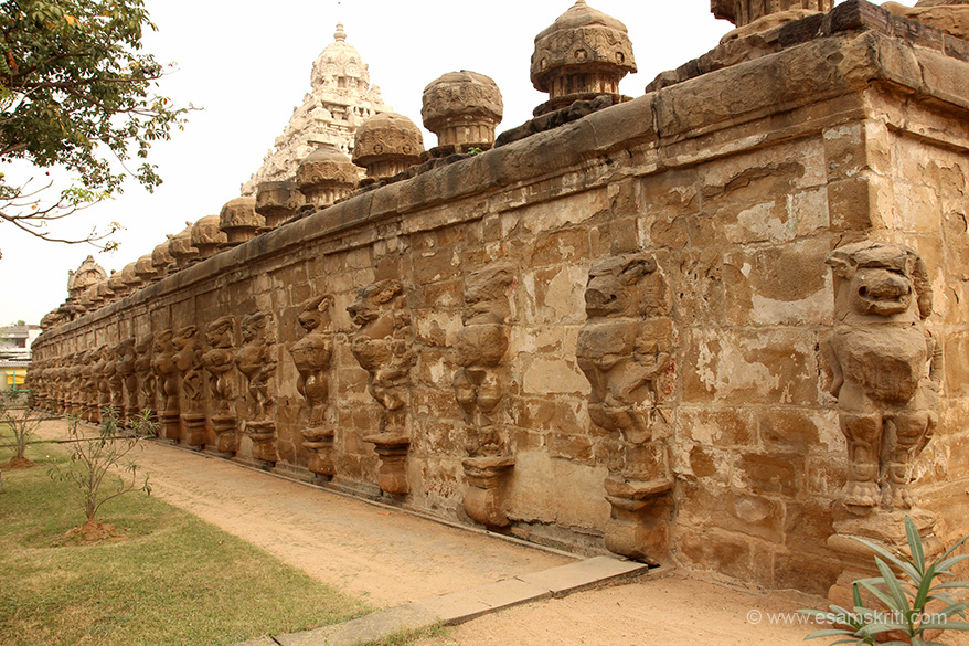 "Side view. Lion in standing pose all along the external wall. ""It is one of the oldest structural stone temple in Tamil Nadu. Built mainly using sandstone and holds many frescos that stood time""."