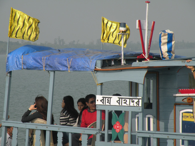 The morning sun falls on travelers on another Sunderbans boat, the Bagh Bahadur.