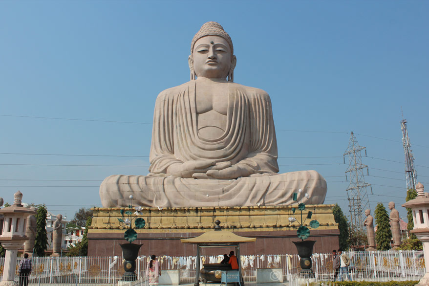 Buddha image is kept on a platform as you can see. Buddha in Dhyan mudra. Note the electricity wires in the background - spoils the background. Wish they realign it.