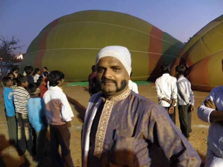 Whilst the fans were making the balloons big as you can see in the background I saw this smart man with a uniquely styled moustache. Like me there were many others who were attracted by the hot air balloon, he was one of them.