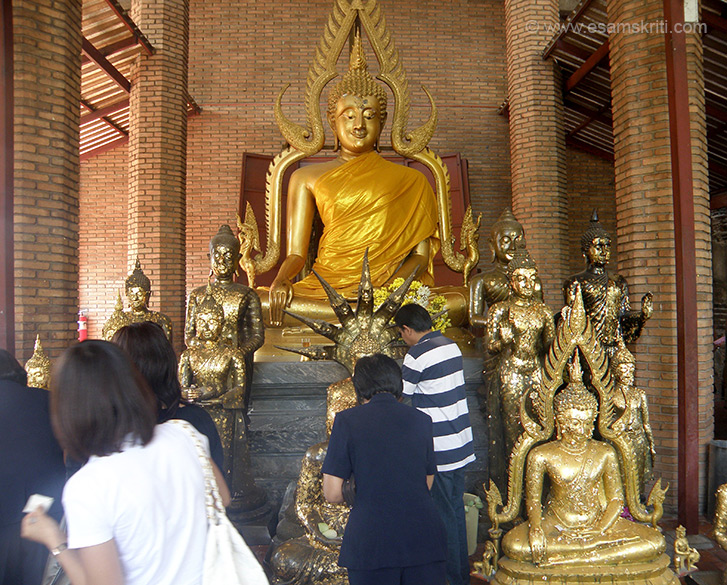 You see an image of Buddha in the hall. Thais afix a thin gold strip paper on the smaller Buddhas as you can see in this picture. You can reach Ayutthaya by train or boat from Bangkok. Am told the boat journey is very good.