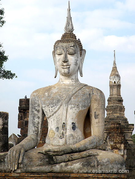 A close up of the Buddha image that you saw earlier. Very imposing. The key stupa is in right of picture.