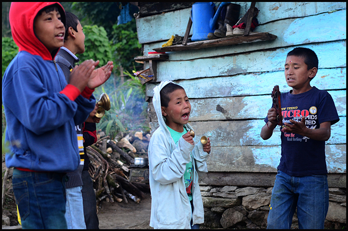 "Children singing the ""Tika"" song and visiting houses."