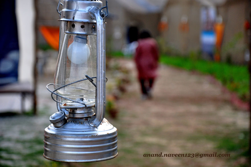 The traditional oil lamp is now powered by electricity, and the CFL bulb needs very little of it..