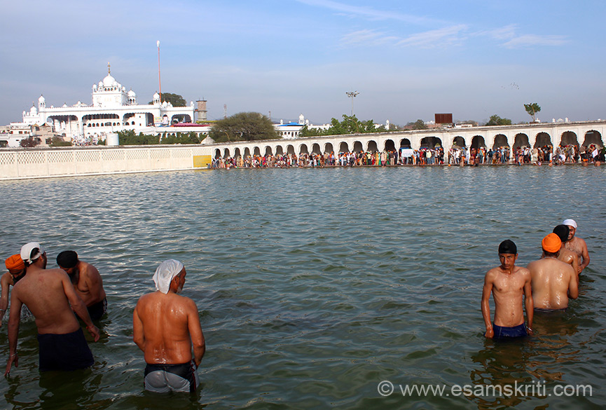 White structure is Sri Keshgarh Sahib where Khalsa was born. In front is the Holy Sarovar (similar to one at Amritsar) where devotees have a dip before going for darshan (matha tekna) at Keshgarh Sahib.