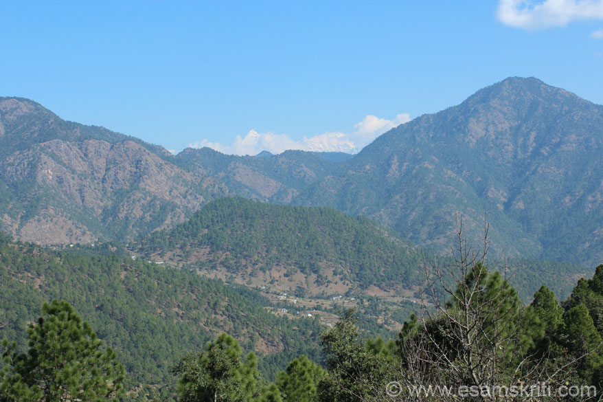 Clicked from Dungagiri town - on your left is the Pandukholi (is on top of hill app 9,000 feet) and somewhere in the hill is the cave. On your right is Bhatkot (the highest peak in the region at