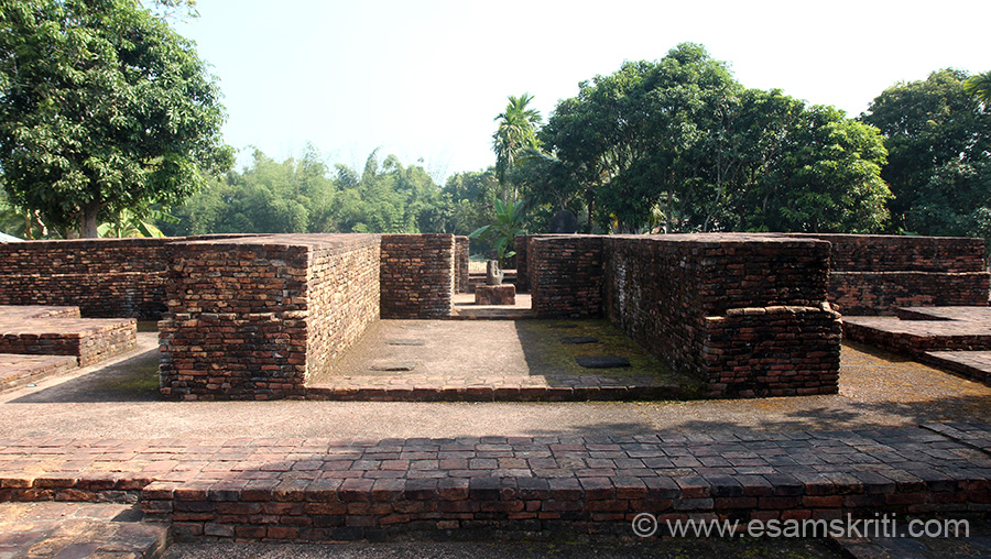 Another view of the monastic complex. In centre is ruins of stupa. Parikrama passage right in front. Brick work on left and right of pic represent 2 of the 4 subsidiary shrines.