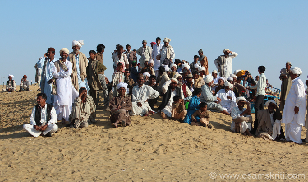 Group of locals watching the camel race. Area has a large number of Muslims whom you see in this pic. Most camels owned by Muslims. Bargain hard for camel ride but like everywhere