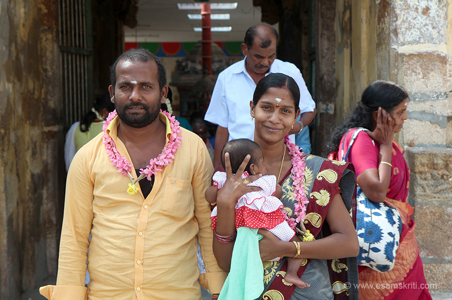 "This newly married couple and parent all smiles. ""There is yet another speciality about this sthalam. One among the form of Lord Shiva is Arulmighu Dhakshina moorthy in Yoga ( in deep tapas) form and to get him out of that tapas, Manmadhan, the got of love threw an arrow of flower on Shiva Perumaan; Lord Shiva opened his 3rd eye from the forehead and made Manmadhan into Ash; Rathi devi wife of Manmadhan requested Lord Shiva to get her husband back and got him in this Thirumanancheri Sthalam only."""