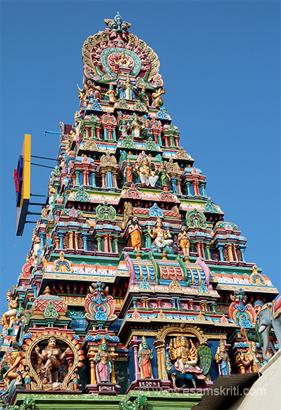 "Side view of north side gopuram. Stucco images, left is of Nataraja. Top Kirti Mukha to keep away evil spirits. ""The temple was damaged to a great extent and the Gopurams were demolished and razed to ground in the year 1740 when the Anglo-French War was waged later when war broke out between Hyder Ali and the British."""