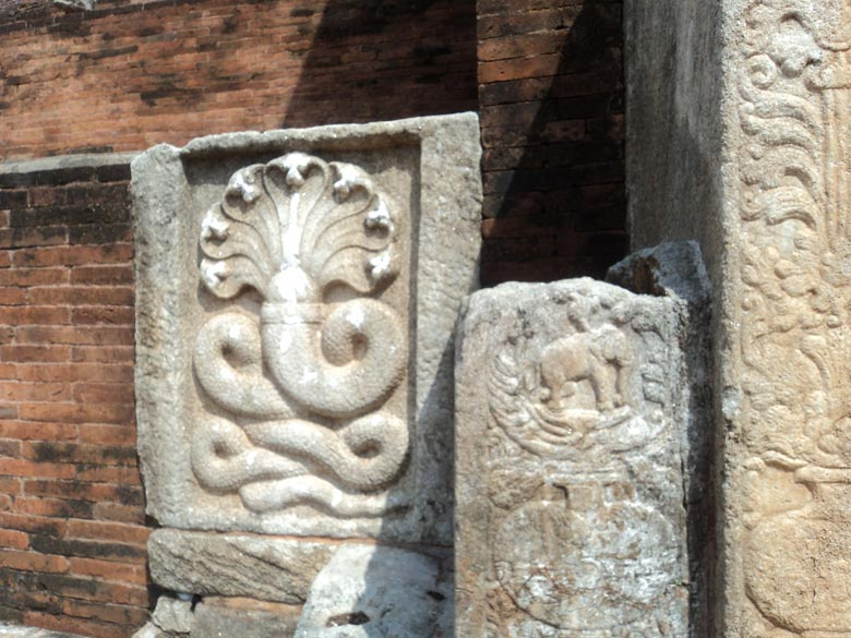 A Ganesha made from a serpent. Such images line the base of the stupa all around. Very interesting. Since am from India the Guide specifically pointed this image to me.