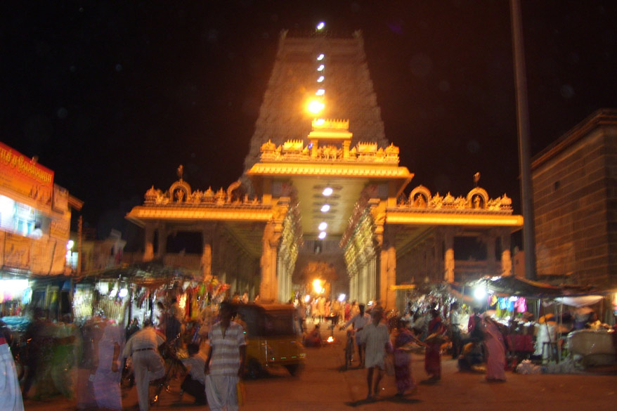 U see temple at night. As of today the temple plan includes five Prakarams in total. And in each Prakaram there are Nandhi statues placed facing the Lord Arunachaleswarar temple. The fifth Prakaram is the outer most Prakaram and it has four Gopurams on all four different sides of the temple. They are the Thirumanjana gopuram, Ammaniammal gopuram, Pei  gopuram and the Rajagopuram. This splendid temple architecture owes its due to King Krishnadevarayar of the Vijayanagaram kingdom. At this fifth Prakaram there is also a thousand pillared mandapam besides a holy tank called Shiv Ganga tank. Do darshan of the Shiv Lingam.