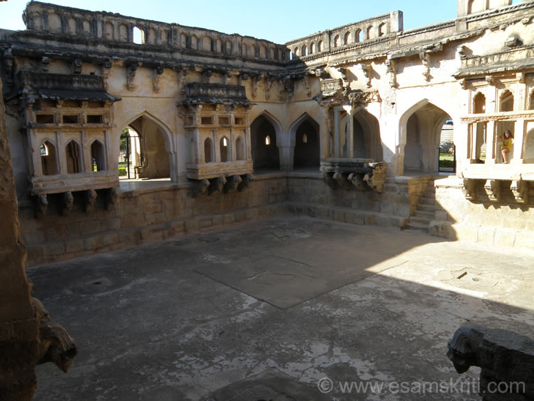 U see the Queen``s Bath. It is a large square structure with a plain exterior and an ornate interior. It has a bath, 15 m square and 1.8 m deep, surrounded by decorated corridors and projecting balconies. It is called Queen``s bath probably it is located near the Royal Enclosure. Belief is that it was built by Achyuta Rai (1529-42).