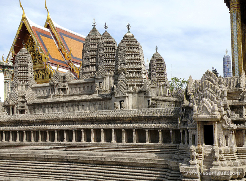 You see a miniature Angkor Wat crafted at the order of King Rama IV. Angkor Wat in Cambodia is probably the largest temple complex in the world. Esamskriti has pictures of Angkor Wat.