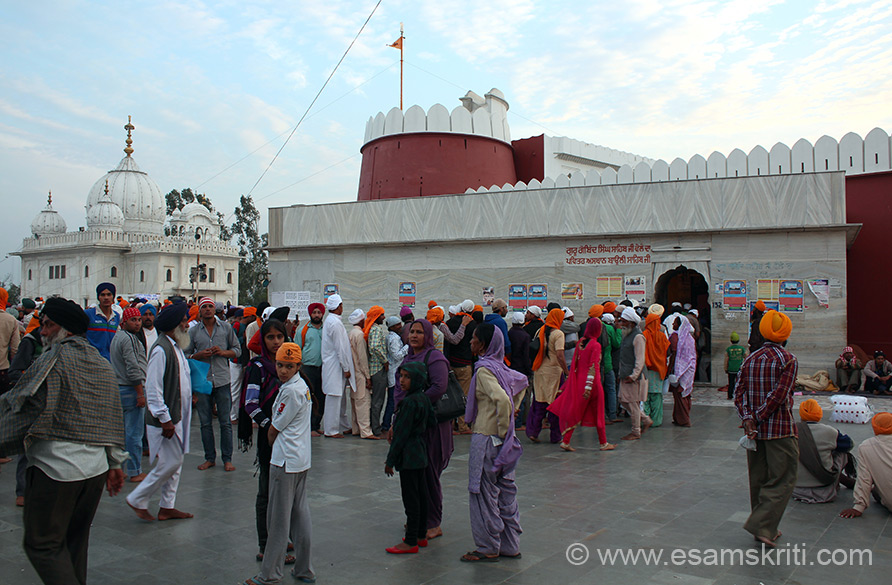 Left is Anandgarh Sahib Gurudwara. Right red painted structure is a small fort. It is the point where the 10th Sikh Guru hit the ground with an arrow and water came out. To this day water flows from that spot. U see devotees in line to enter fort. Many of them carry small bottles and fill it with water to take home.