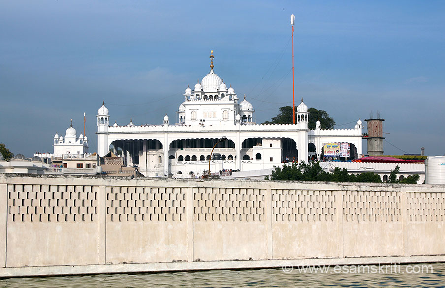 A view of Keshgarh Sahib from the Sarovar. Each letter of the Persian word Khalsa has significance. ``Kh`` and ``a`` stand for one-self and the Akal Purukh. ``L`` signifies Labbaik meaning the following 