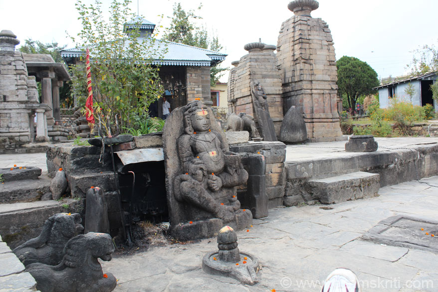 In front of the main temple referred to earlier (that you see behind the tree) are these images.