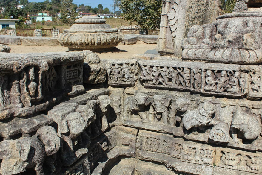 A side view of the plinth. Centre of pic is close up of dome that was originally on top of temple. Group of 8 temples are dedicated to Mrityunjay, Dhawj, Badrinath, Durga, Gujar Dev, 