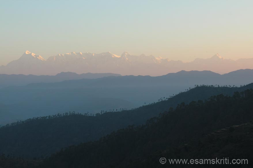 Sun rise on the Himalayan Peaks. On the Raniket Almora road visit UMANG. It is a network of hill women which sells super hand knitted woollens, organic products, jams etc. To see pics <a target=_blank href=http://www.esamskriti.com/photo-detail/UMANG-Raniket.aspx>Click here</a>