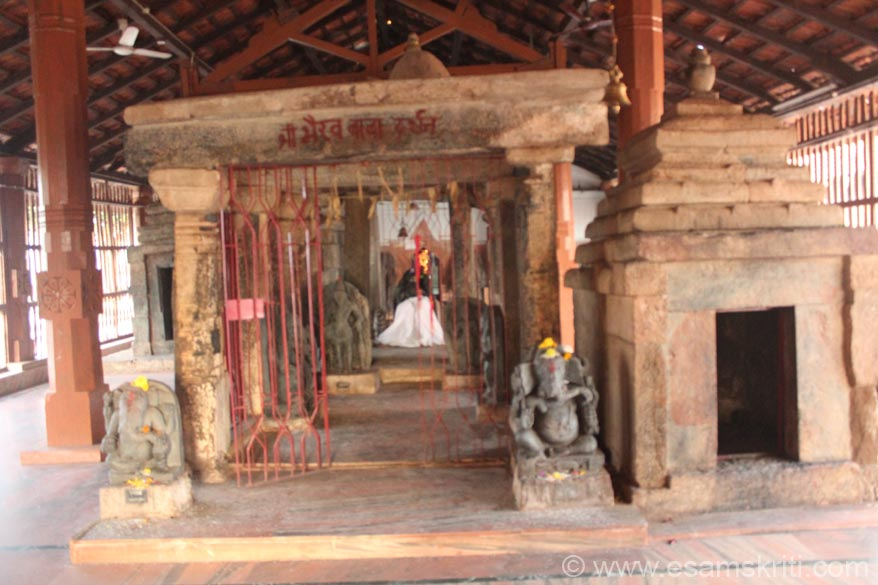 View as you enter temple. In centre of pic golden light is image of Ma Danteshwari. Over the years stone carvings were collected and placed. U see a small temple. Note Ganeshas on either