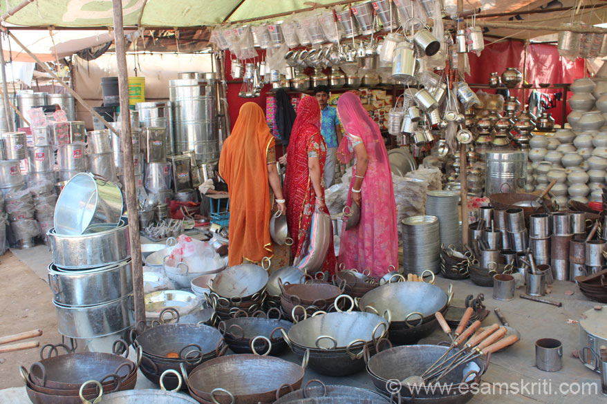 There are many shops selling utensils. U see some local ladies speaking to the shop owner. Love their colorful clothes which is why clicked with them facing the other side. They were nice   enough to let me click them. To see them go to the People of Marwar collection.