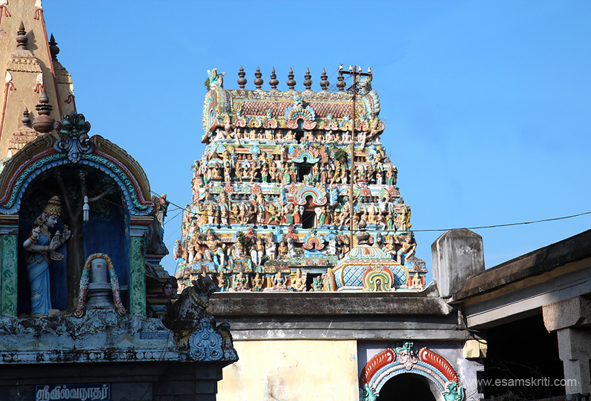 Left worship of Siva Lingam. Close up of upper portion of smaller gopuram as we entered temple.