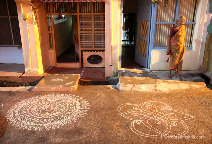 It was Pongal time. During the month of Margazhi (dec15-jan15) it is customary for women in Tamil Nadu to get up early in the morning and draw the KOLAM in front of the house. Took this pic on my way to temple.