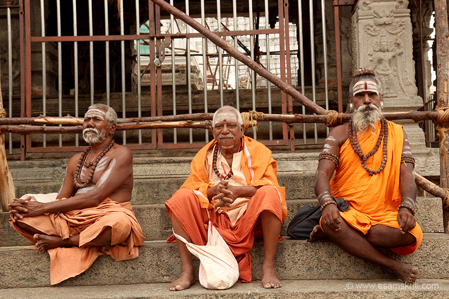 "Sadhus inside temple. One on the right is glowing. ""Arunachala is surrounded by eight lingams (Asta Lingams) each residing in one of the eight directions of the four cardinal points 