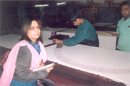 Similar work being done. White dyed fabric being imprinted with local design. This unit was a larger one with about 20 workers and was situated on the first floor. The Chhipa owner lived on the ground floor, see on right of picture. I asked him whether bi