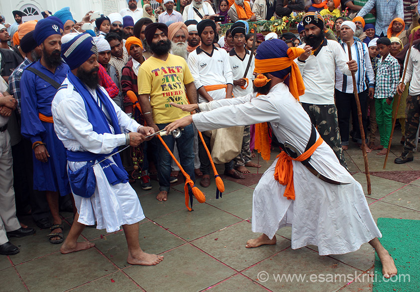 U see blindfolded person collect 2 swords after which he brandishes the swords and crowds cheer him. Key is to ensure that whilst doing so he does not hurt anyone so requires him to sense where the crowds stand. ``Though the origin of Gatka is not definitely known, yet some evidences shows that it existed in India in ancient times in the form of stick-fighting``.