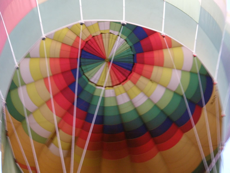 Somehow I managed to sit right below the balloon and take this picture. Really colorful inside. I could not make the trip since the flight was full but tagged along with the support team and tracked the balloons till they landed.