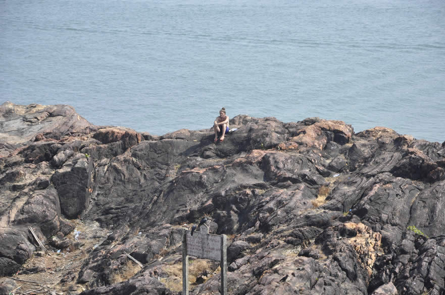 To the left of the rock formation that you saw in the earlier picture you see a foreigner enjoying the breeze in solitude. Gokarna is an important centre of Sanskrit learning.