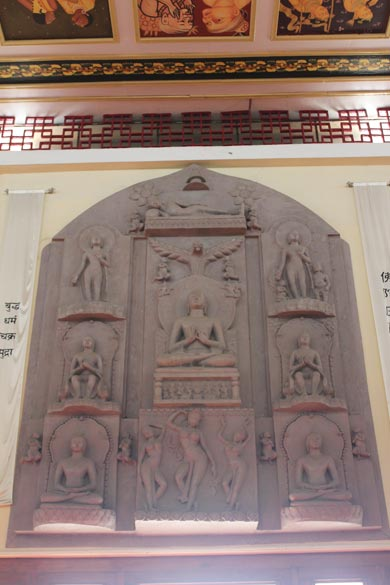 Just above the hall entrance are these images of Buddha. Wish someone can help with a description. An authoritative catalogue of the Buddhist canon prepared in the T``ang period mentions