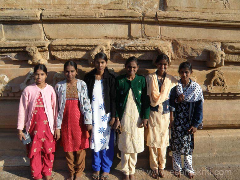 The biggest temple complex in Aihole is the one that has Durg Temple. This group of smiling and lively girls from Badami insisted that I take their picture in front of the plinth of the Durg Temple. Not the sculptures above their heads and on right of picture.