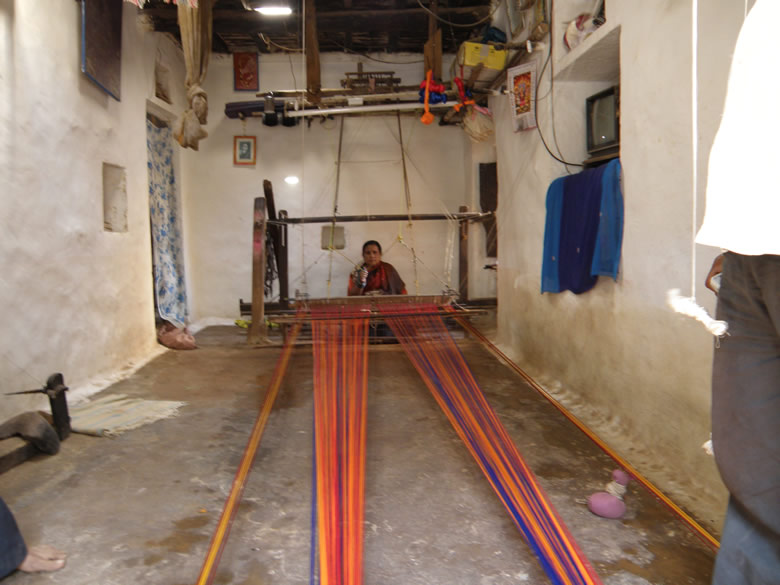 I went into the neighboring house and saw lady with one powerloom. Host told me that virtually every house has one powerloom. Clearly wages play an important part of the village economy.