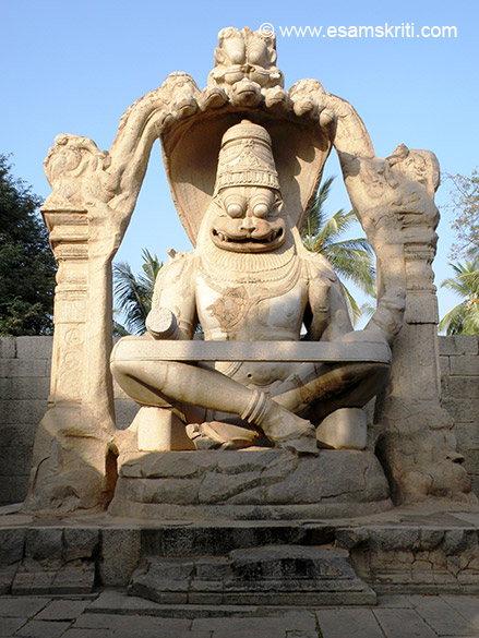 The four arms of the statue and the seated figure of his consort Lakshmi are missing. The image was one of the last additions by Krishnadeva Raya to Vijayanagara. The deity was 